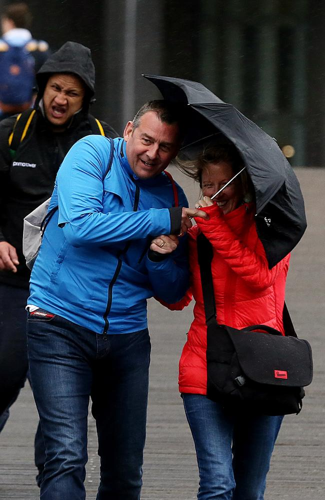 A wintry storm rolls into Melbourne with people seeking shelter however they can. Picture: Alex Coppel