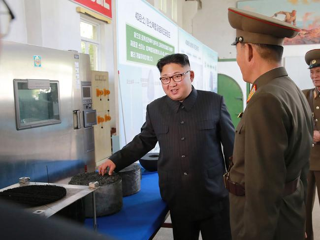 Kim Jong-un on the guided tour. Picture: AFP/KCNA via KNS