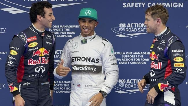 Ricciardo and Vettel lock eyes as they stand either side of Hamilton after Chinese GP qualifying