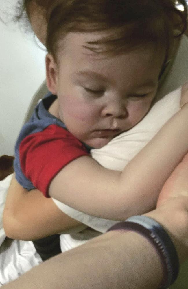 Brain-damaged toddler Alfie Evans cuddles his mother Kate James at Alder Hey Hospital. Picture: Alfies Army Official via AP