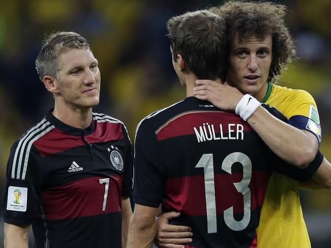 David Luiz hugs German star Thomas Mueller after the game.