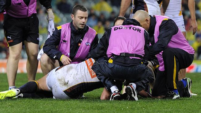 Dean Cox is attended to by medical staff after the incident. Photo by Daniel Wilkins.