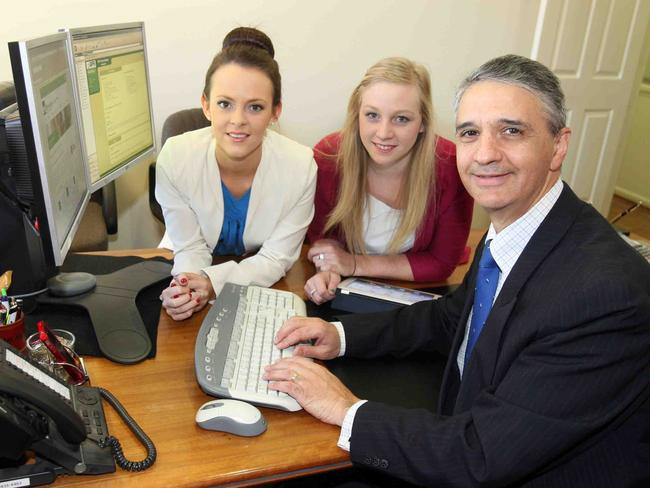 Better than grads ... accounting cadets Justine Radnedge and Jemma Chandler being tutored by Paul Fiumara partner in accounting firm DFK Hirn Newey.