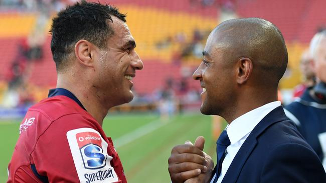 George Smith celebrates with former teammate George Gregan after winning his 150th Super Rugby match.
