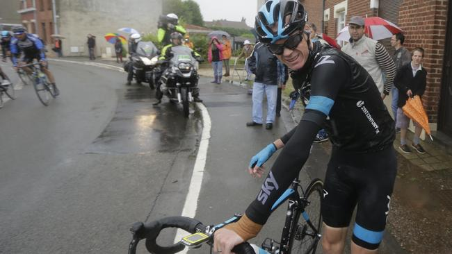 Britain's Christopher Froome grimaces as he gets up after his third crash during the fifth stage of the Tour de France.