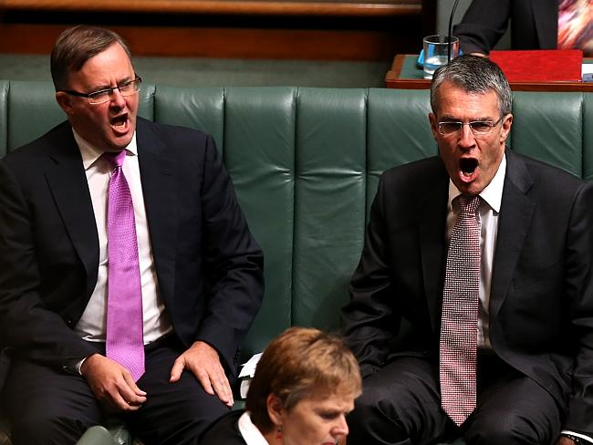 Please explain: Labor's Mark Dreyfus, pictured with Anthony Albanese (L) has demanded an explanation from the Abbott government.