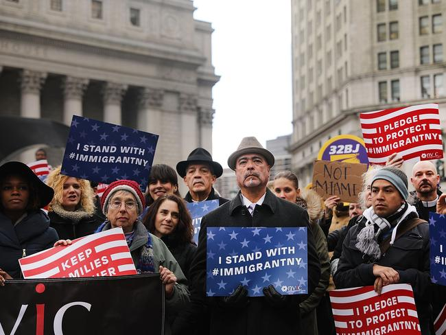 Muslims and local immigration activists participate in a prayer and rally against Mr Trump's immigration policies in New York City. Picture: Spencer Platt/Getty Images/AFP