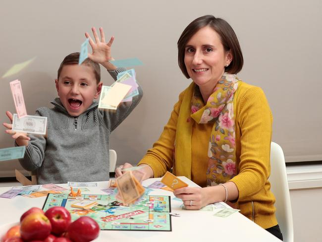 Kristin Tunbridge, with son Bailey, says money lessons can start young. Picture: Dylan Coker