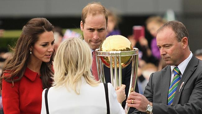 Countdown ... Catherine and William inspect the Cricket World Cup trophy at Hagley Oval in Christchurch.