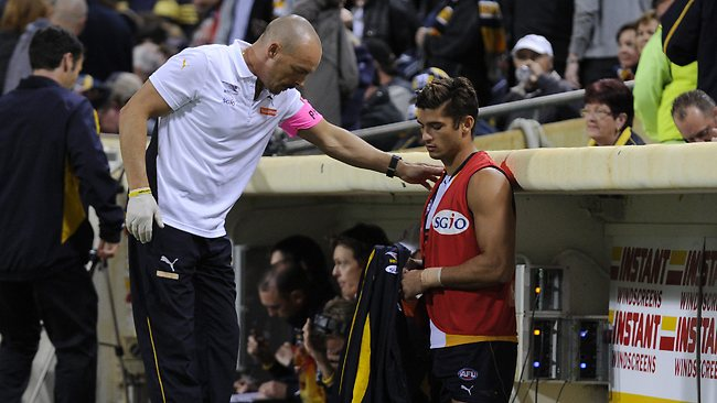 SEEING RED: Sharrod Wellingham sports the sub's vest after suffering an ankle injury. Picture: Daniel Wilkins