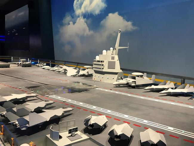 A conceptual model of a 'future aircraft carrier' put on display by the People's Liberation Army at a recent function. It shows drones, stealth fighters and radar early warning aircraft on its deck.
