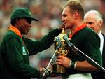 LIBRARY: South African President Nelson Mandela (L) hands over William Webb Ellis Cup trophy to Springboks captain Francois Pienaar after South Africa defeated New Zealand All Blacks in 1995 World Cup (RWC) final at Ellis Park in Johannesburg, 24/06/95.