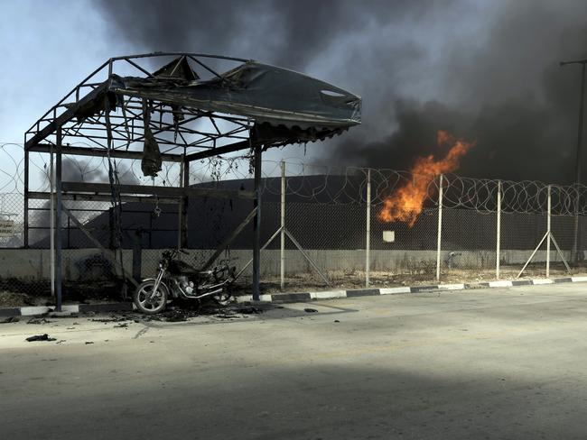 Under siege ... Israel escalated its military campaign against Hamas on Tuesday, firing tank shells that shut down the strip's only power plant. Picture: AP