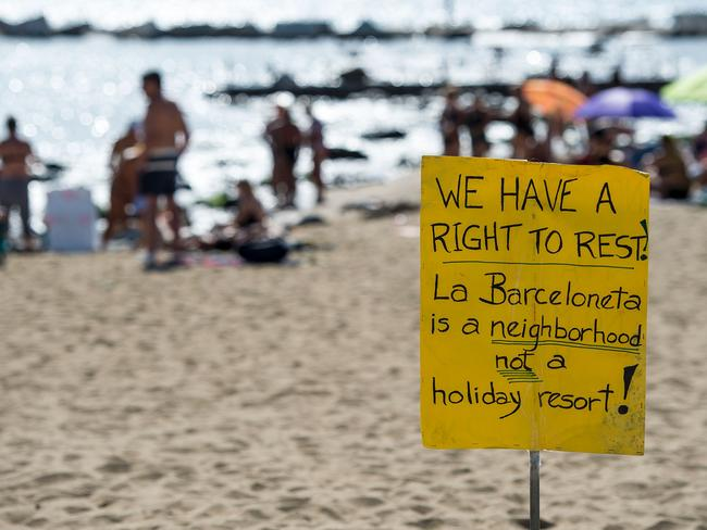 A placard used during a protest against tourism in Barcelona where anti-tourist sentiment has been simmering. Picture: AFP/Josep Lago