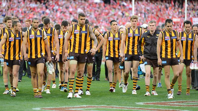 Hawthorn players leave the ground after losing the 2012 Grand Final to Sydney. Picture: David Caird.
