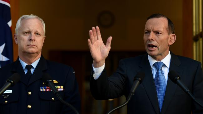 Taking action ... Chief of the Defence Force, Air Chief Marshal Mark Binskin, with Prime Minister Tony Abbott.