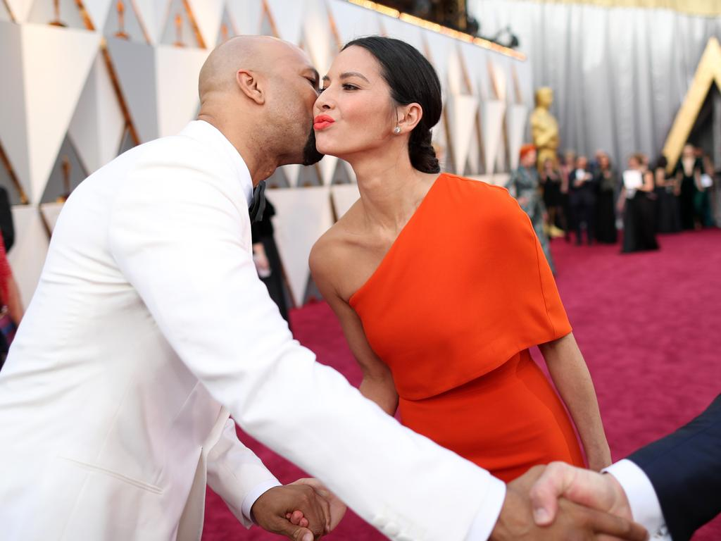 Common and Olivia Munn attend the 88th Annual Academy Awards on February 28, 2016 in Hollywood, California. Picture: Getty