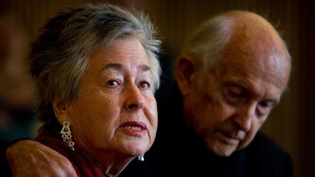 Juris Greste comforts his wife, Lois, during a press conference about the sentencing of their son, Australian Al-Jazeera journalist Peter Greste.
