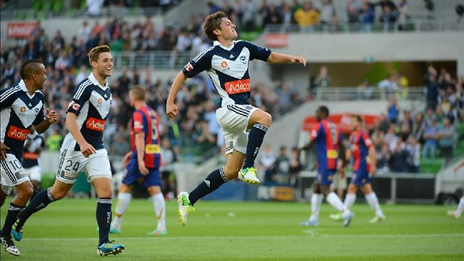 Melbourne Victory's Marcos Rojas takes to the air after scoring against Newcastle. Picture: George Salpigtidis