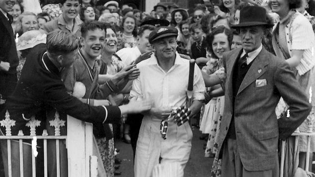 Don Bradman walking out to bat at his testimonial match at the MCG in Melbourne in a 1948 photo.