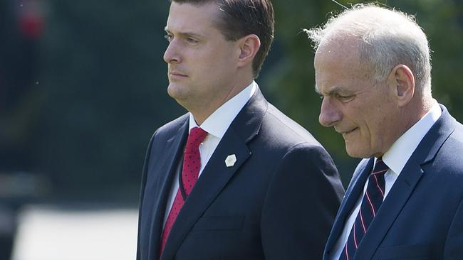 Rob Porter initially received a glowing reference from John Kelly (right). Picture: AFP