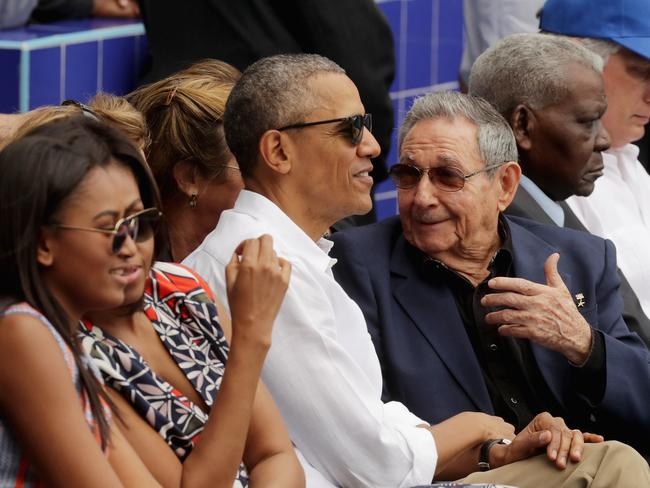 Sasha Obama, U.S. first lady Michelle Obama, President Barack Obama and Cuban President Raul Castro. Picture: Getty.