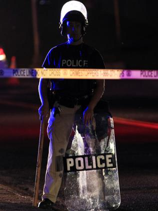 Heavy blue line ... A policeman wearing riot gear in Ferguson, Missouri. Source: AP