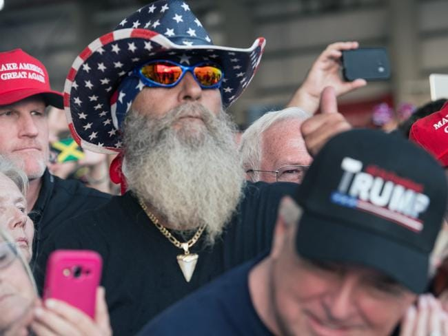 Supporters of US President Donald Trump listen during the rally in Melbourne, Florida. Picture: AFP