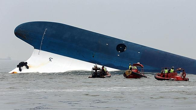 Search and rescue ... The South Korea Coast guard look for survivors after a ferry capsized en route to Jeju Island. Picture: Yonhap