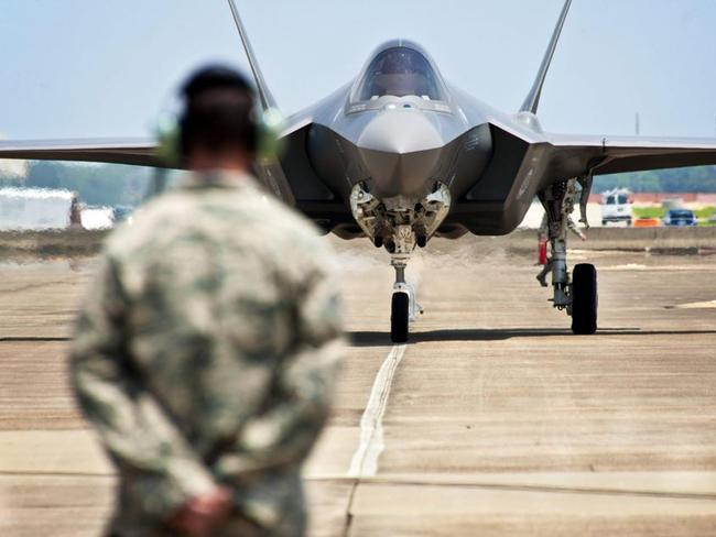 Jack of all trades, master of none? ... a prototype F-35 Lightning II fighter jet at Eglin Air Force Base, Florida. The US military on 22 February 2013 grounded all flights by its F-35 jets after a crack was found in the engine of one of the planes.