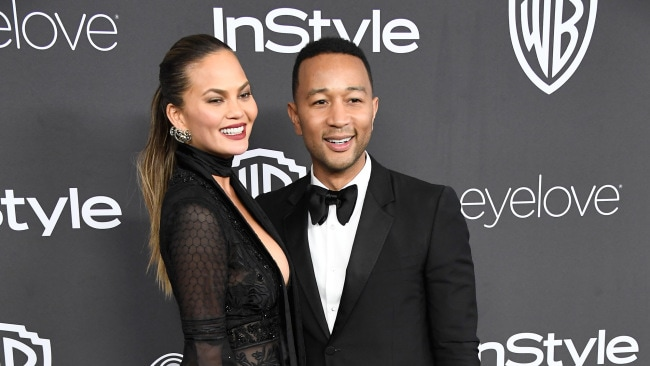 Chrissy Teigen and John Legend at the Golden Globes. Photo: Getty