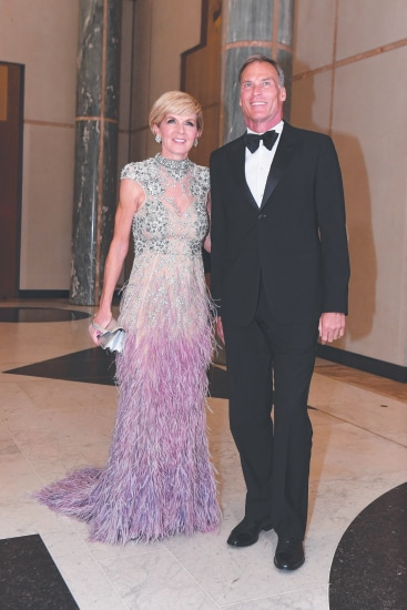 Australian Foreign Minister Julie Bishop and partner David Panton arrive for the annual Mid Winter Ball at Parliament House in Canberra, Wednesday, June 14, 2017. (AAP Image/Lukas Coch) NO ARCHIVING