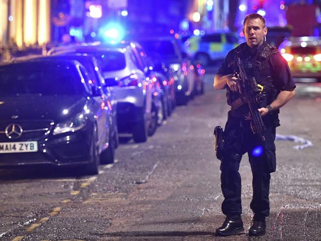 An armed police stands on Borough High Street as police are dealing with an incident on London Bridge in London, Saturday, June 3, 2017. Witnesses reported a vehicle hitting pedestrians and injured people on the ground. (Dominic Lipinski/PA via AP)