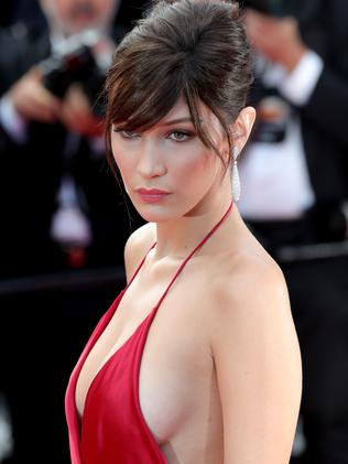 Bella Hadid wearing a red slip of fabric, also sometimes called a dress on the red carpet in Cannes. Picture: Neilson Barnard