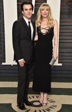 Director Nicholas Jarecki (L) and recording artist Courtney Love attend the 2016 Vanity Fair Oscar Party. (Photo by Pascal Le Segretain/Getty Images)