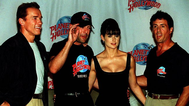 Sylvester Stallone and Bruce Willis (pictured with Arnold Schwarzenegger and Demi Moore) back in happier days in 1995 when they opened their Planet Hollywood chain together.