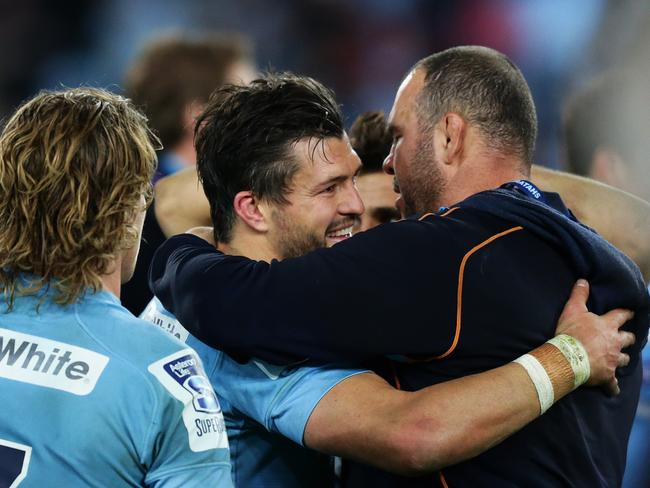 Adam Ashley-Cooper embraces Michael Cheika after his man-of-the-match performance in the final.