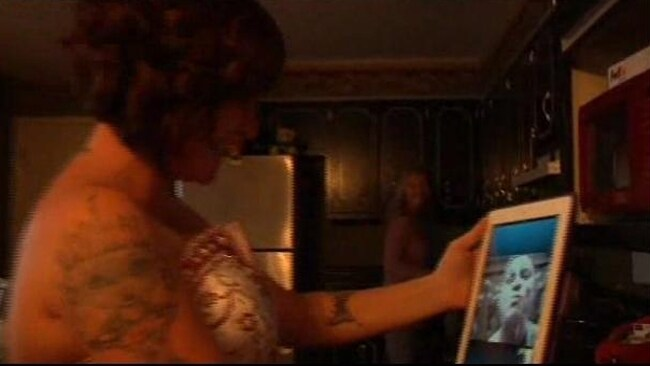 Trey Durham blows wife Jennifer a kiss after they wed over Skype via an iPad.