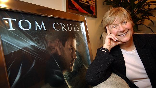 Pat Kingsley, founder of public relations powerhouse PKG, which represents Tom Cruise among others, poses next to a movie poster for the actor at her office in 2002. Picture: Getty