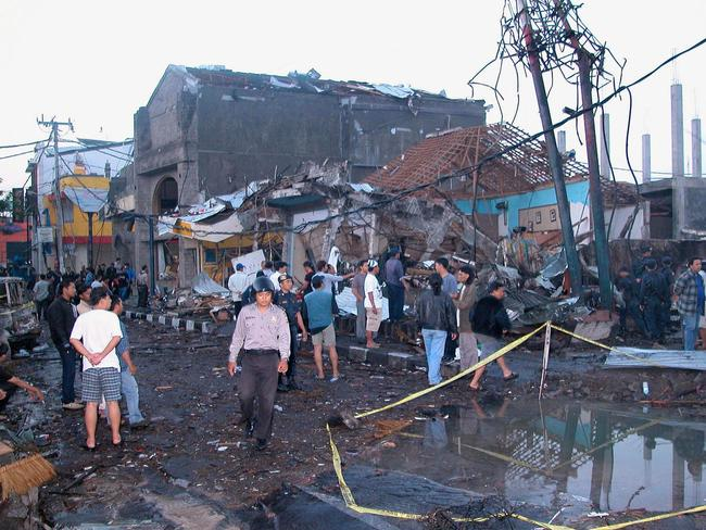 Police and onlookers during a site of a fear 2002 explosve blasts in Kuta. Picture: AFP