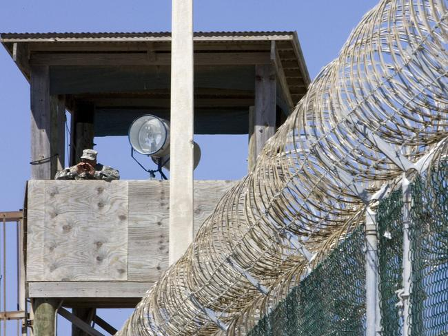 Time to go ... A guard at Guantánamo Bay. Picture: AFP