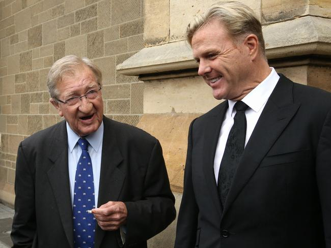 John Elliott and Dermott Brereton outside the cathedral. Picture: Wayne Ludbey