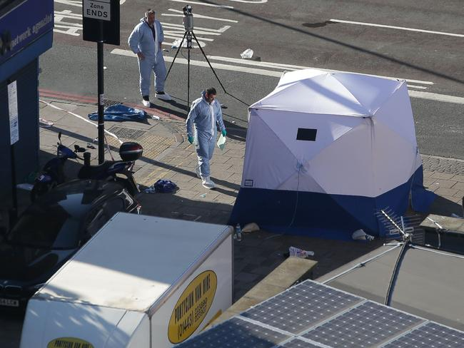 A forensic tent has been erected at the scene. Picture: AFP PHOTO / Daniel LEAL-OLIVAS