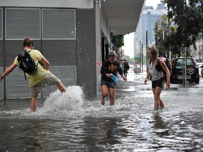 Some people enjoyed the aftermath of the downpour. Picture: Nicki Connolly
