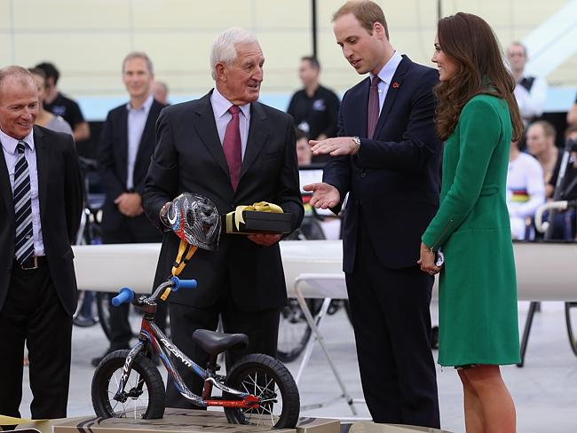 A new bike for prince Geroge ... Prince William, Duke of Cambridge and Catherine, Duchess of Cambridge receive a bicycle for Prince George from John Struthers (L), founder of Avanti New Zealand. Picture: Jason Oxenham/Getty Images