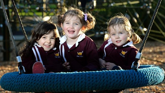 Isabella, 4, Scarlet, 3, and Tallulah, 3, at the Wombat Waterhole playground in Hazelwood Park. Picture: Noelle Bobrige.