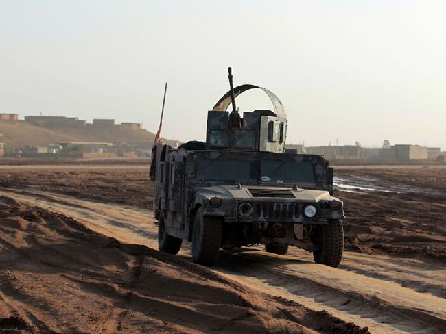 Shiite fighters from the Popular Mobilisation Units drive a heavily armed military vehicle near the village of Ayn Nasir, south of Mosul, yesterday during an ongoing operation against Islamic State. Picture: Ahmad Al-Rubaye