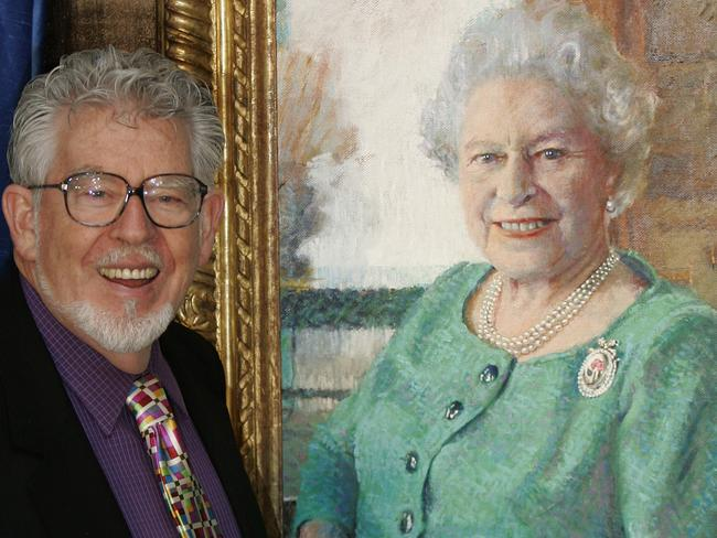 Artist Rolf Harris stands with his portrait of Britain's Queen Elizabeth II in 2005. Picture: AP