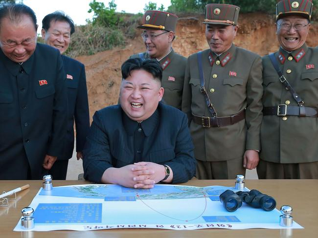 North Korean leader Kim Jong-un pictured during a recent test of a ground-to-ground medium long-range strategic ballistic rocket Hwasong-12. Picture: AFP