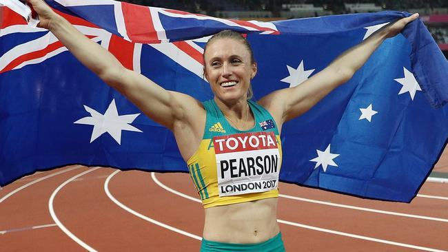 Sally Pearson celebrates winning gold at the World Athletics Championships in London.